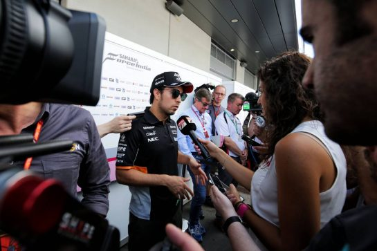 Sergio Perez (MEX) Sahara Force India F1 with the media.