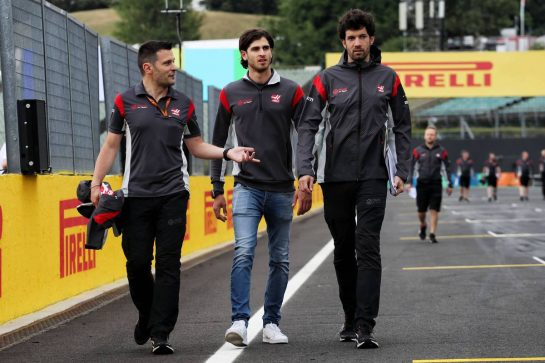 Antonio Giovinazzi (ITA) Haas F1 Team Test Driver (Centre) walks the circuit. 27.07.2017. Formula 1 World Championship, Rd 11, Hungarian Grand Prix, Budapest, Hungary, Preparation Day. - www.xpbimages.com, EMail: requests@xpbimages.com - copy of publication required for printed pictures. Every used picture is fee-liable. © Copyright: Photo4 / XPB Images
