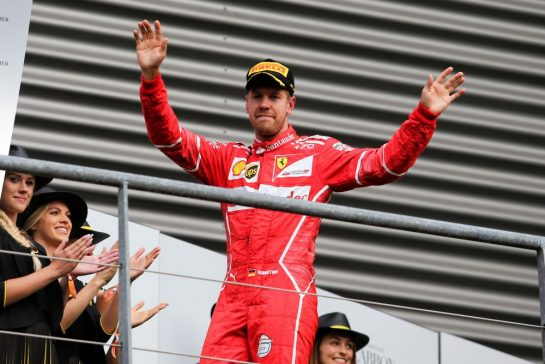 Sebastian Vettel (GER) Ferrari celebrates his second position on the podium. 27.08.2017. Formula 1 World Championship, Rd 12, Belgian Grand Prix, Spa Francorchamps, Belgium, Race Day. - www.xpbimages.com, EMail: requests@xpbimages.com - copy of publication required for printed pictures. Every used picture is fee-liable. © Copyright: Moy / XPB Images