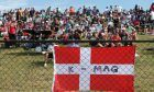 Fans and a flag for K-Mag - Kevin Magnussen (DEN)