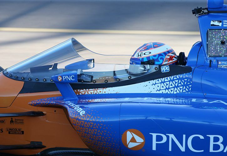 Scott Dixon rolls out of pit lane with the new windshield fitted