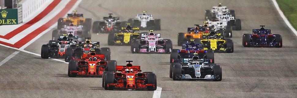 Sebastian Vettel (GER) Ferrari SF71H leads at the start of the Brahain Grand Prix