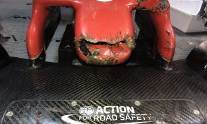 The front wing of Romain Grosjean's Haas is badly damaged after hitting a groundhog at the Circuit Gilles Villeneuve.