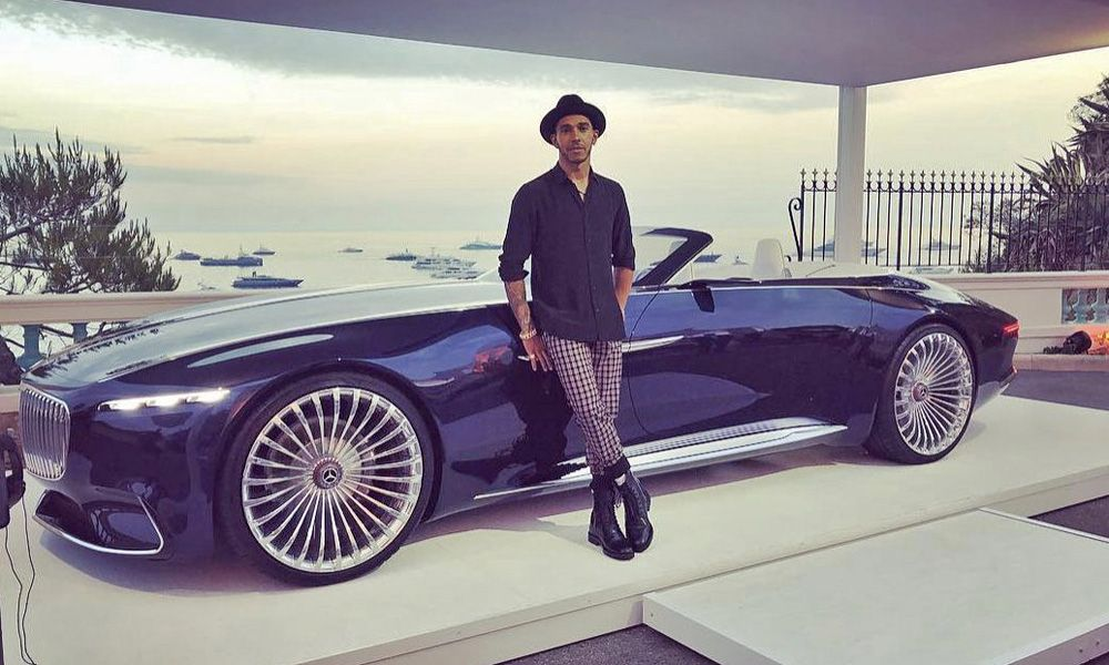Lewis Hamilton poses with the Maybach 6.