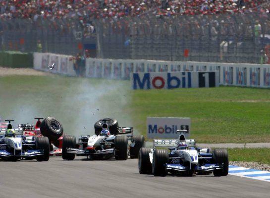 03.08.2003 Hockenheim, Deutschland,F1 am Hockenheimring, Start zum GP von Deutschland, CRASH / Unfall von Kimi Raikkonen, (Räikkönen, FIN, 06), West McLaren Mercedes, MP4-17D, auf der Strecke (Track) hinten Rubens Barrichello (BR, Ferrari)  - Sonntag, Formel 1 Grand Prix (GP), Großer Preis von Deutschland 2003 (Länge 4.574m, Baden Württemberg) -  LEGAL NOTICE: THIS PICTURE IS NOT FOR UK (Great Britain, England...) PRINT USE, KEINE PRINT BILDNUTZUNG IN ENGLAND! - Alle Bilder auf www.xpb.cc, eMail: info@xpb.cc - Abdruck ist honorarpflichtig. © Copyrightnachweis: xpb.cc