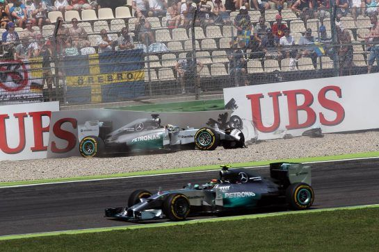 Pole sitter Nico Rosberg (GER) Mercedes AMG F1 W05 passes his team mate Lewis Hamilton (GBR) Mercedes AMG F1 W05, who crashed out of the first session of qualifying. 19.07.2014. Formula 1 World Championship, Rd 10, German Grand Prix, Hockenheim, Germany, Qualifying Day.  - www.xpbimages.com, EMail: requests@xpbimages.com - copy of publication required for printed pictures. Every used picture is fee-liable. © Copyright: Herweg / XPB Images