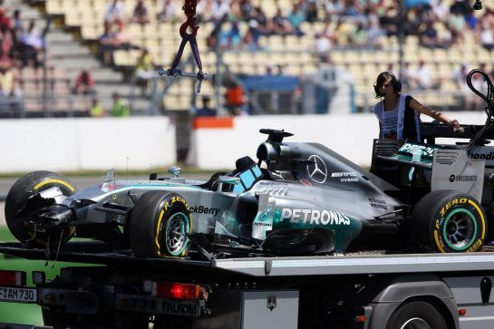 The Mercedes AMG F1 W05 of Lewis Hamilton (GBR) Mercedes AMG F1 is recovered back to the pits on the back of a truck after he crashed out of the first session of qualifying. 19.07.2014. Formula 1 World Championship, Rd 10, German Grand Prix, Hockenheim, Germany, Qualifying Day.  - www.xpbimages.com, EMail: requests@xpbimages.com - copy of publication required for printed pictures. Every used picture is fee-liable. © Copyright: Herweg / XPB Images