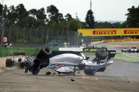 Felipe Massa (BRA) Williams FW36 crashes at the start of the race, avoided by Daniel Ricciardo (AUS) Red Bull Racing RB10. 20.07.2014. Formula 1 World Championship, Rd 10, German Grand Prix, Hockenheim, Germany, Race Day. - www.xpbimages.com, EMail: requests@xpbimages.com - copy of publication required for printed pictures. Every used picture is fee-liable. © Copyright: Charniaux / XPB Images