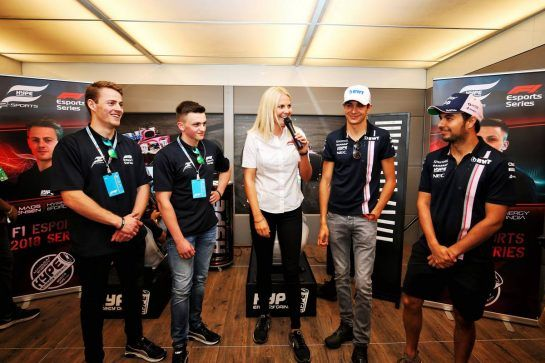 The Hype Energy eForce India team launch (L to R): Mads Sorensen (DEN) Hype Energy eForce India; Marcel Kiefer (GER) Hype Energy eForce India; Rosanna Tennant (GBR) F1 Presenter; Esteban Ocon (FRA) Sahara Force India F1 Team; and Sergio Perez (MEX) Sahara Force India F1. 05.07.2018. Formula 1 World Championship, Rd 10, British Grand Prix, Silverstone, England, Preparation Day. - www.xpbimages.com, EMail: requests@xpbimages.com - copy of publication required for printed pictures. Every used picture is fee-liable. © Copyright: Moy / XPB Images