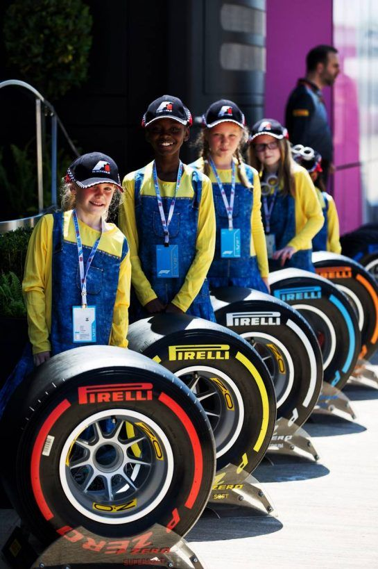 F1 In Schools children with Pirelli tyres. 05.07.2018. Formula 1 World Championship, Rd 10, British Grand Prix, Silverstone, England, Preparation Day.  - www.xpbimages.com, EMail: requests@xpbimages.com - copy of publication required for printed pictures. Every used picture is fee-liable. © Copyright: Rew / XPB Images