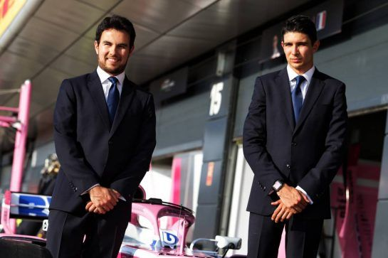 (L to R): Sergio Perez (MEX) Sahara Force India F1 and Esteban Ocon (FRA) Sahara Force India F1 Team - Apsley Tailors. 05.07.2018. Formula 1 World Championship, Rd 10, British Grand Prix, Silverstone, England, Preparation Day. - www.xpbimages.com, EMail: requests@xpbimages.com - copy of publication required for printed pictures. Every used picture is fee-liable. © Copyright: Moy / XPB Images