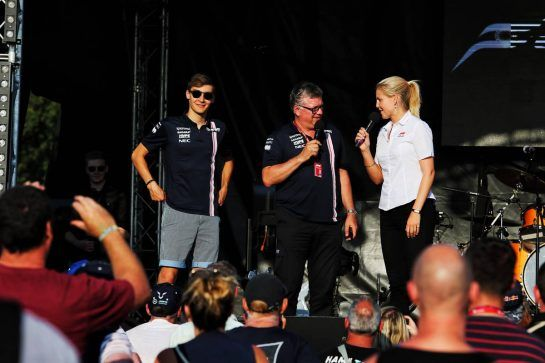 (L to R): George Russell (GBR) Sahara Force India F1 Test Driver with Otmar Szafnauer (USA) Sahara Force India F1 Chief Operating Officer and Rosanna Tennant (GBR) F1 Presenter on stage at the Sahara Force India F1 Team Fan Zone. 06.07.2018. Formula 1 World Championship, Rd 10, British Grand Prix, Silverstone, England, Practice Day. - www.xpbimages.com, EMail: requests@xpbimages.com - copy of publication required for printed pictures. Every used picture is fee-liable. © Copyright: Moy / XPB Images