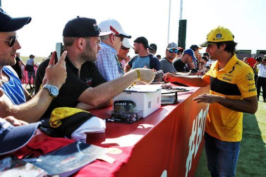 Carlos Sainz Jr (ESP) Renault Sport F1 Team signs autographs for the fans. 07.07.2018. Formula 1 World Championship, Rd 10, British Grand Prix, Silverstone, England, Qualifying Day. - www.xpbimages.com, EMail: requests@xpbimages.com - copy of publication required for printed pictures. Every used picture is fee-liable. © Copyright: Batchelor / XPB Images