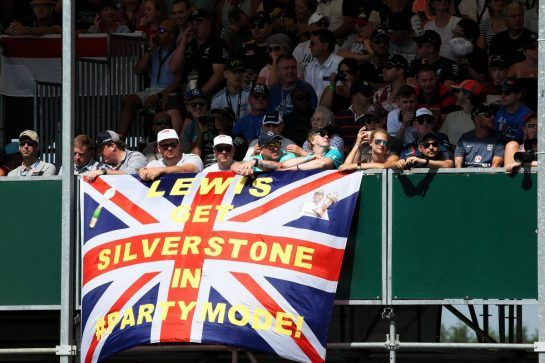 Lewis Hamilton (GBR) Mercedes AMG F1 fans in the grandstand and a flag. 07.07.2018. Formula 1 World Championship, Rd 10, British Grand Prix, Silverstone, England, Qualifying Day. - www.xpbimages.com, EMail: requests@xpbimages.com - copy of publication required for printed pictures. Every used picture is fee-liable. © Copyright: Batchelor / XPB Images