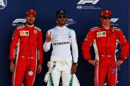 Qualifying top three in parc ferme (L to R): Sebastian Vettel (GER) Ferrari, second; Lewis Hamilton (GBR) Mercedes AMG F1, pole position; Kimi Raikkonen (FIN) Ferrari, third. 07.07.2018. Formula 1 World Championship, Rd 10, British Grand Prix, Silverstone, England, Qualifying Day. - www.xpbimages.com, EMail: requests@xpbimages.com - copy of publication required for printed pictures. Every used picture is fee-liable. © Copyright: Photo4 / XPB Images