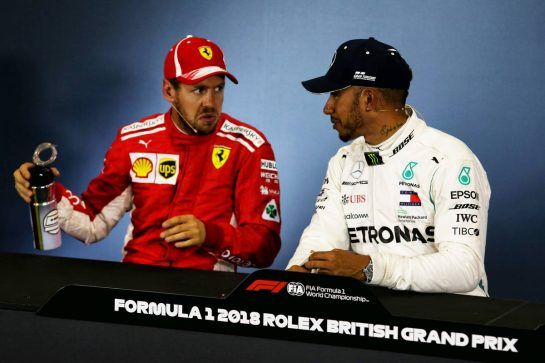 (L to R): Sebastian Vettel (GER) Ferrari with Lewis Hamilton (GBR) Mercedes AMG F1 in the FIA Press Conference. 07.07.2018. Formula 1 World Championship, Rd 10, British Grand Prix, Silverstone, England, Qualifying Day. - www.xpbimages.com, EMail: requests@xpbimages.com - copy of publication required for printed pictures. Every used picture is fee-liable. © Copyright: Moy / XPB Images