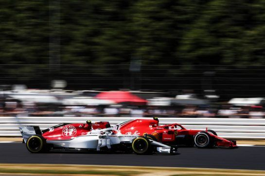 Kimi Raikkonen (FIN) Ferrari SF71H leads Charles Leclerc (MON) Sauber F1 Team C37. 07.07.2018. Formula 1 World Championship, Rd 10, British Grand Prix, Silverstone, England, Qualifying Day. - www.xpbimages.com, EMail: requests@xpbimages.com - copy of publication required for printed pictures. Every used picture is fee-liable. © Copyright: Moy / XPB Images