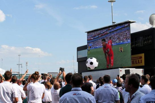 The England vs Sweden World Cup Quarter Final is shown on a big screen at the Heineken Bar in the paddock. 07.07.2018. Formula 1 World Championship, Rd 10, British Grand Prix, Silverstone, England, Qualifying Day. - www.xpbimages.com, EMail: requests@xpbimages.com - copy of publication required for printed pictures. Every used picture is fee-liable. © Copyright: Batchelor / XPB Images