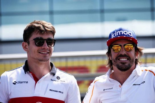 (L to R): Charles Leclerc (MON) Sauber F1 Team with Fernando Alonso (ESP) McLaren on the drivers parade. 08.07.2018. Formula 1 World Championship, Rd 10, British Grand Prix, Silverstone, England, Race Day. - www.xpbimages.com, EMail: requests@xpbimages.com - copy of publication required for printed pictures. Every used picture is fee-liable. © Copyright: Batchelor / XPB Images