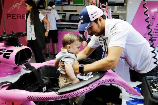 Sergio Perez (MEX) Sahara Force India F1 with his son Sergio Perez Jnr (MEX) in the Sahara Force India F1 VJM11. 08.07.2018. Formula 1 World Championship, Rd 10, British Grand Prix, Silverstone, England, Race Day. - www.xpbimages.com, EMail: requests@xpbimages.com - copy of publication required for printed pictures. Every used picture is fee-liable. © Copyright: Moy / XPB Images