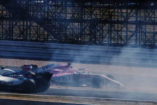 Sergio Perez (MEX) Sahara Force India F1 VJM11 spins off at the start of the race, narrowly missed by Sergey Sirotkin (RUS) Williams FW41 leaving the pit lane. 08.07.2018. Formula 1 World Championship, Rd 10, British Grand Prix, Silverstone, England, Race Day. - www.xpbimages.com, EMail: requests@xpbimages.com - copy of publication required for printed pictures. Every used picture is fee-liable. © Copyright: Charniaux / XPB Images
