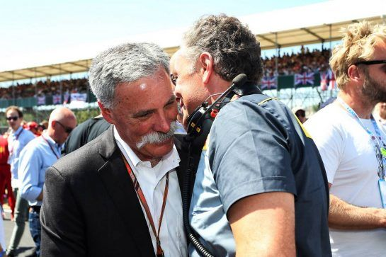 (L to R): Chase Carey (USA) Formula One Group Chairman with Mario Isola (ITA) Pirelli Racing Manager on the grid. 08.07.2018. Formula 1 World Championship, Rd 10, British Grand Prix, Silverstone, England, Race Day. - www.xpbimages.com, EMail: requests@xpbimages.com - copy of publication required for printed pictures. Every used picture is fee-liable. © Copyright: Photo4 / XPB Images