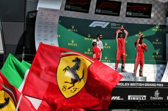 The podium (L to R): Lewis Hamilton (GBR) Mercedes AMG F1, second; Sebastian Vettel (GER) Ferrari, race winner; Kimi Raikkonen (FIN) Ferrari, third. 08.07.2018. Formula 1 World Championship, Rd 10, British Grand Prix, Silverstone, England, Race Day. - www.xpbimages.com, EMail: requests@xpbimages.com - copy of publication required for printed pictures. Every used picture is fee-liable. © Copyright: Moy / XPB Images
