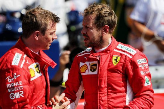 (L to R): Kimi Raikkonen (FIN) Ferrari with team mate and race winner Sebastian Vettel (GER) Ferrari in parc ferme. 08.07.2018. Formula 1 World Championship, Rd 10, British Grand Prix, Silverstone, England, Race Day. - www.xpbimages.com, EMail: requests@xpbimages.com - copy of publication required for printed pictures. Every used picture is fee-liable. © Copyright: Moy / XPB Images