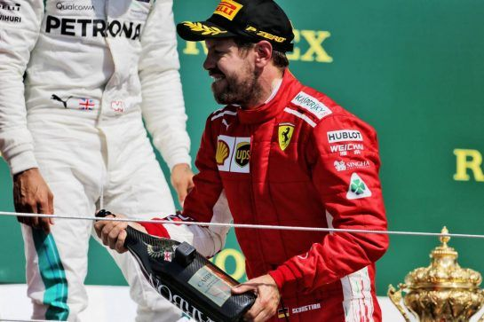 Race winner Sebastian Vettel (GER) Ferrari celebrates on the podium. 08.07.2018. Formula 1 World Championship, Rd 10, British Grand Prix, Silverstone, England, Race Day. - www.xpbimages.com, EMail: requests@xpbimages.com - copy of publication required for printed pictures. Every used picture is fee-liable. © Copyright: Moy / XPB Images