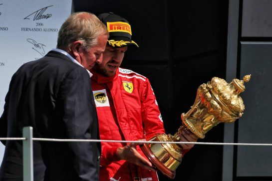 Race winner Sebastian Vettel (GER) Ferrari on the podium with Martin Brundle (GBR) Sky Sports Commentator. 08.07.2018. Formula 1 World Championship, Rd 10, British Grand Prix, Silverstone, England, Race Day. - www.xpbimages.com, EMail: requests@xpbimages.com - copy of publication required for printed pictures. Every used picture is fee-liable. © Copyright: Moy / XPB Images