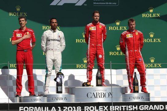 1st place Sebastian Vettel (GER) Ferrari SF71H, 2nd place Lewis Hamilton (GBR) Mercedes AMG F1 W09 and 3rd place Kimi Raikkonen (FIN) Ferrari SF71H. 08.07.2018. Formula 1 World Championship, Rd 10, British Grand Prix, Silverstone, England, Race Day.- www.xpbimages.com, EMail: requests@xpbimages.com - copy of publication required for printed pictures. Every used picture is fee-liable. © Copyright: Batchelor / XPB Images