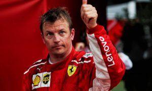 Kimi Raikkonen (FIN) Ferrari celebrates his third position in parc ferme.