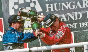 Nigel Mansell and Aryton Senna celebrate on the podium after the 1992 Hungarian Grand Prix.