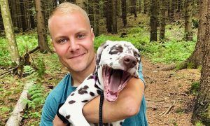 Mercedes driver Valtteri Bottas and his new dog Fanni.