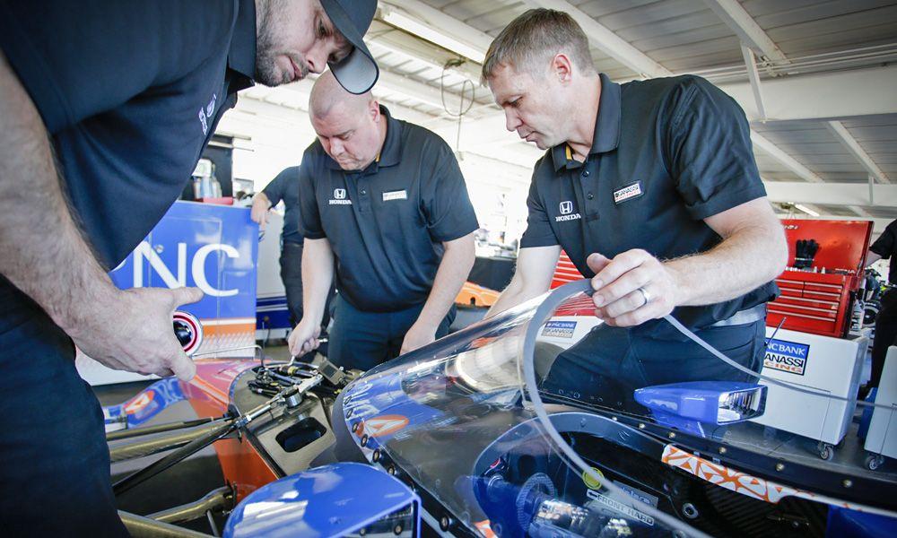 Chip Ganassi Racing installs the windscreen on Scott Dixon's car