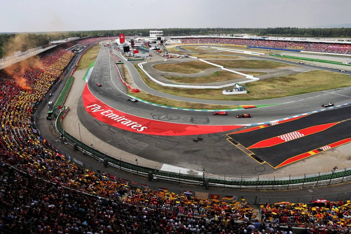 German Grand Prix: Sebastian Vettel (GER) Ferrari SF71H leads Valtteri Bottas (FIN) Mercedes