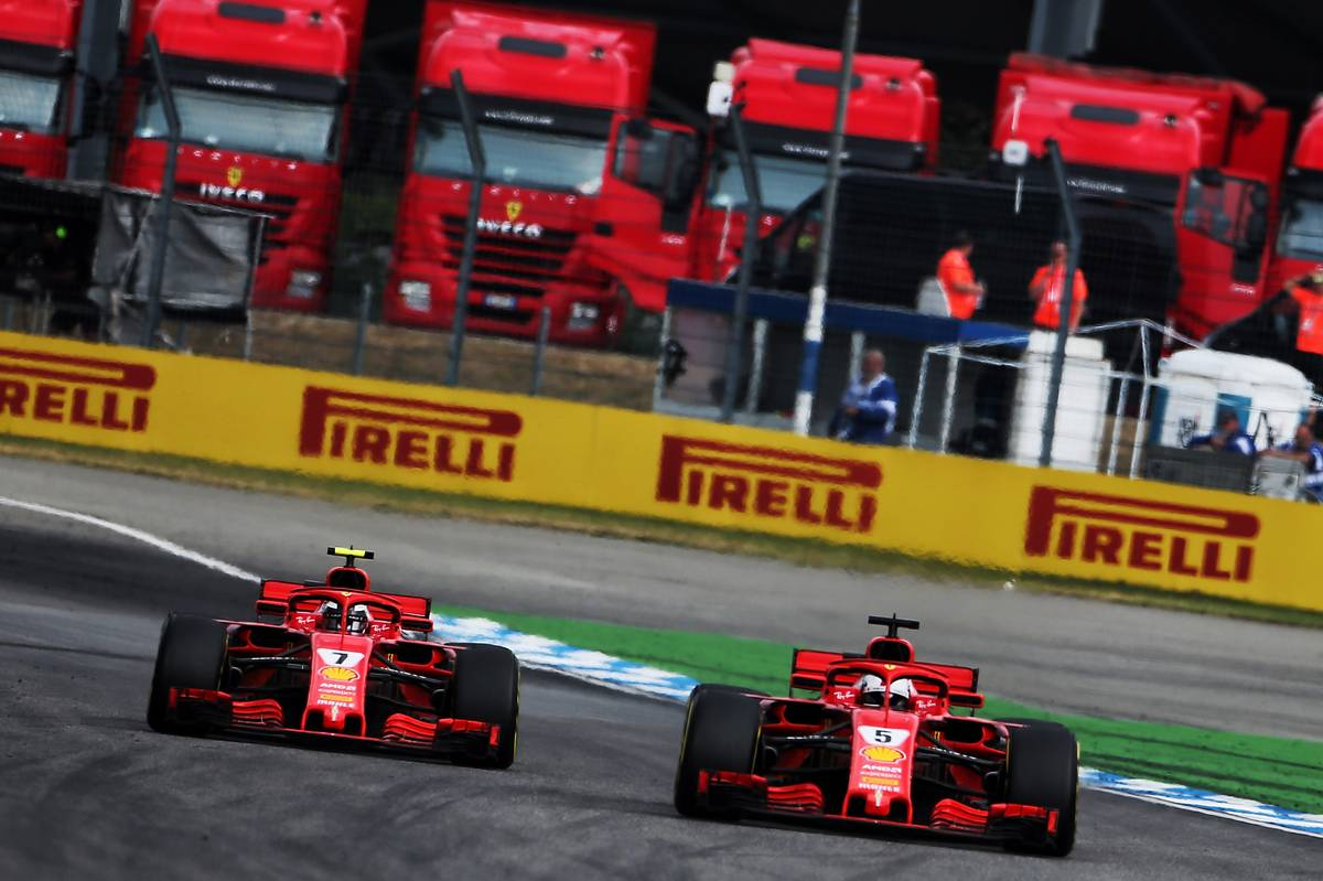 Sebastian Vettel (GER) Ferrari SF71H passes team mate Kimi Raikkonen