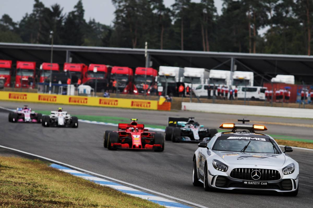 Kimi Raikkonen (FIN) Ferrari SF71H leads behind the FIA Safety Car.