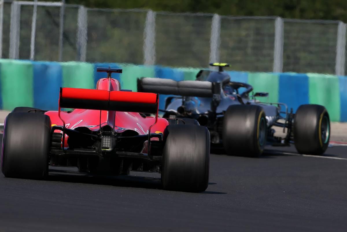 Sebastian Vettel (GER) Scuderia Ferrari and Valtteri Bottas