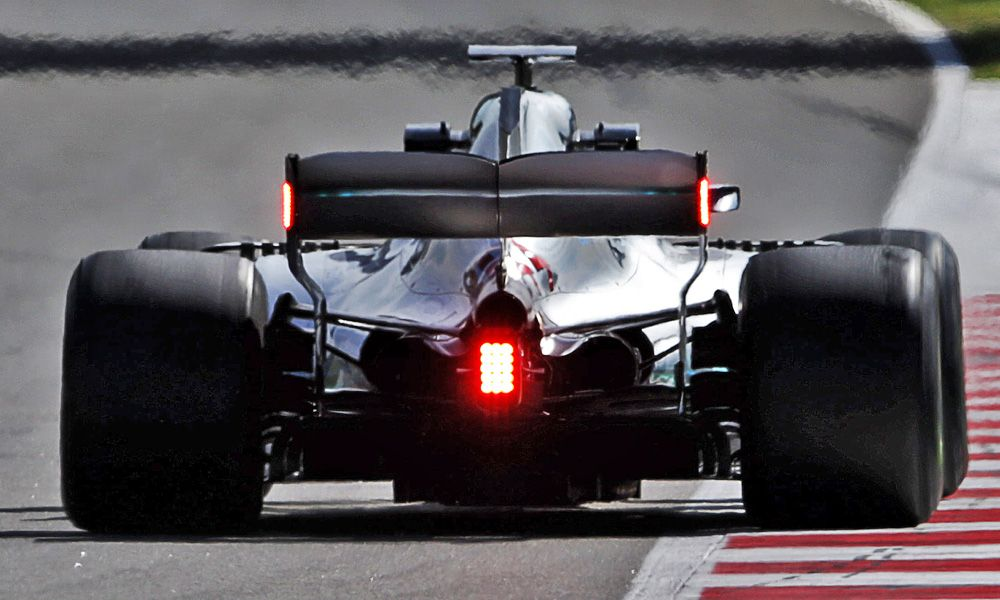 Lewis Hamilton (GBR) Mercedes AMG F1 W09 with red led lights on the rear wing.